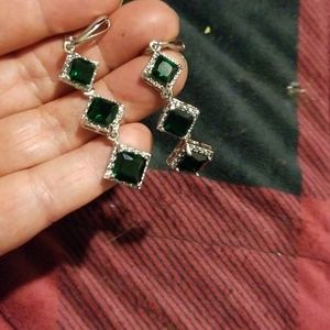 Silver dangling 3 emerald gems on pierced earrings